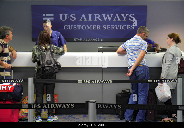 North Carolina Charlotte Charlotte Douglas International Airport CLT terminal concourse gate area US Airways Customer - Stock Image