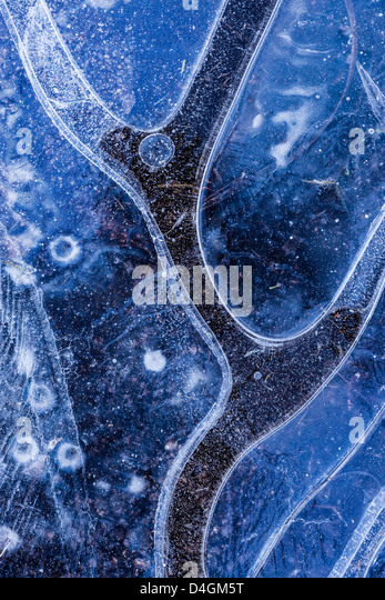Ice pattern in frozen pond, Dartmoor, Devon, England. Winter (December) 2012. - Stock Image