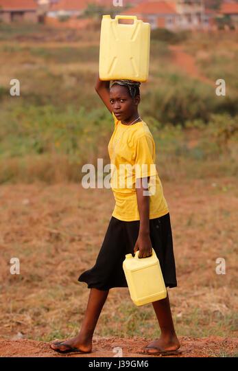 Fetching water in masindi, uganda. - Stock Image