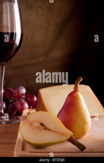 Pear with Wine and Cheese - Stock Image