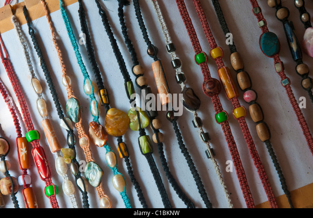 Cheap souvenir bracelets on sale in Indonesia - Stock Image