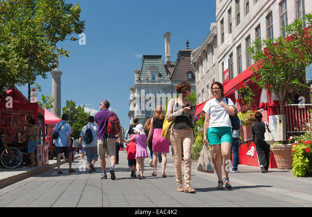 People strolling on Place Jacques Cartier, Old Montreal, Canada. - Stock Image