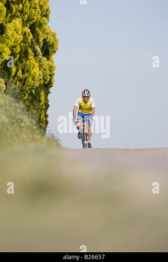 Cyclist riding bicycle,  front view - Stock Image