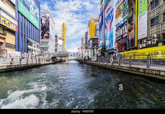 Billboards, Boating, Dotonbori canal, Dotonbori district, Osaka, Japan - Stock Image
