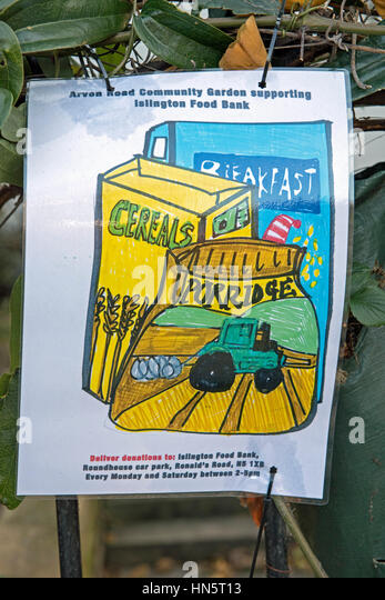 Islington Food Bank notice hanging in and supported by Arvon Road Community Garden, Highbury, London England Britain - Stock Image
