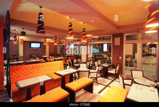 Empty restaurant interior in brown stock photos