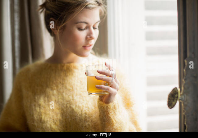 Woman drinking herbal tea - Stock Image