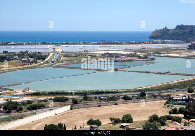 Cagliari salt flat salt pan shallow lagoon skyline landscape rural costal travel holiday vacation destination outside - Stock Image