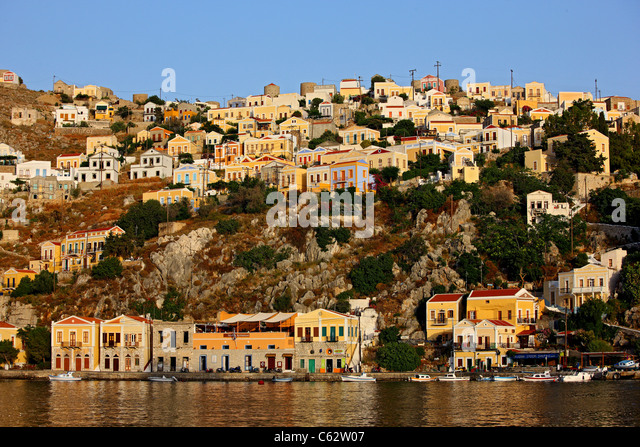 Greece, Symi island, Dodecanese. Partial  view of Gyalos, capital and main port of the island. - Stock-Bilder