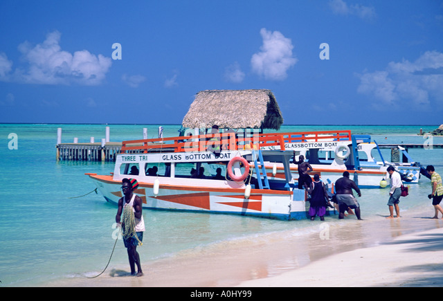 Tobago Pigeon Point caribbean sea tourist boat to Buccoo Coral Reef  - Stock Image