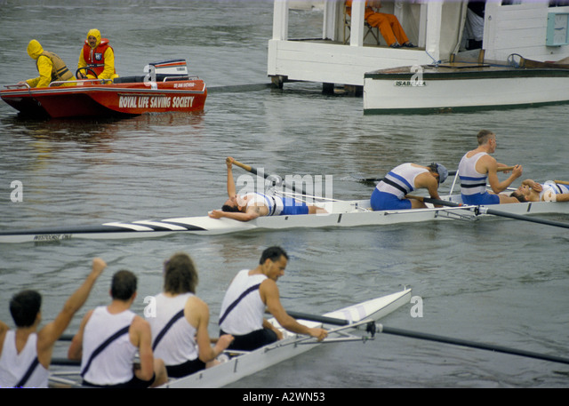 Exhausted male rowers at Henley Royal Regatta Race. - Stock Image