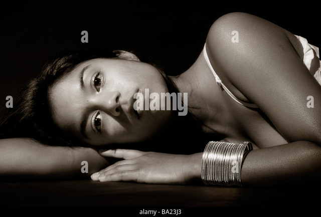 Close-up portrait of woman lying on her side - Stock Image