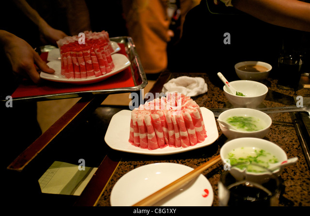 Beef and mutton at Hai Di Lao hot pot restaurant in Beijing, China. 21-Oct-2011 - Stock Image