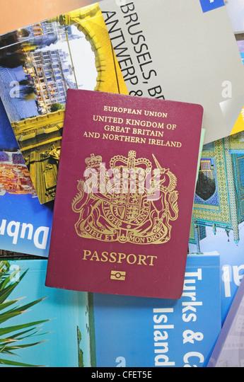A British Passport with Travel Guides - Stock-Bilder