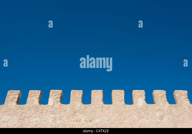 Stucco wall and blue sky - Stock Image