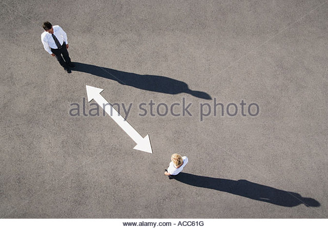 Aerial view of man and woman with arrow on pavement - Stock-Bilder