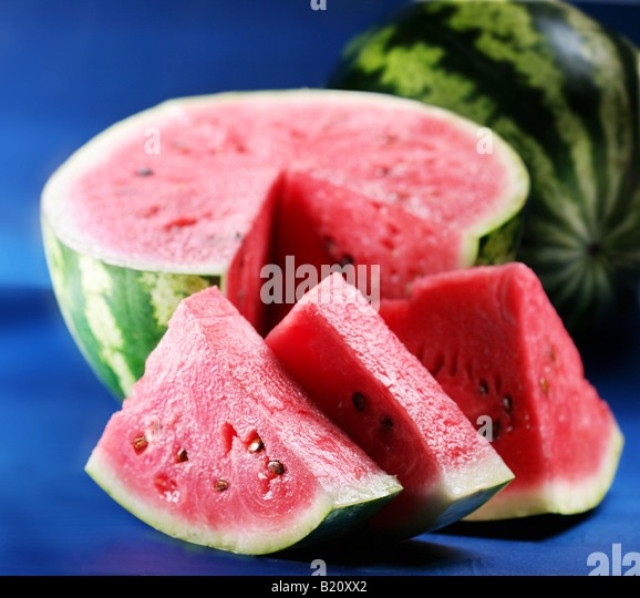 Water melon objects on blue background - Stock Image