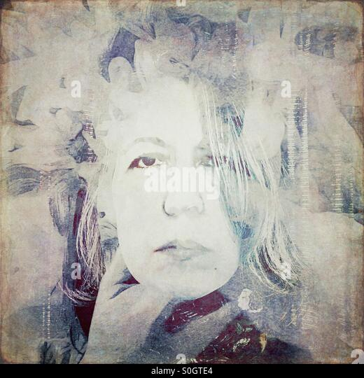 Double exposure of woman with flowers - Stock Image
