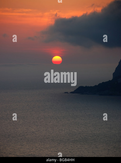 Sunset. A picturesque sunset with fantastic foggy under mountain - Stock-Bilder
