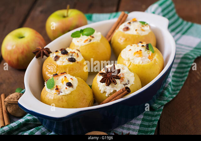 Appetizing baked apples with cottage cheese and raisins - Stock Image