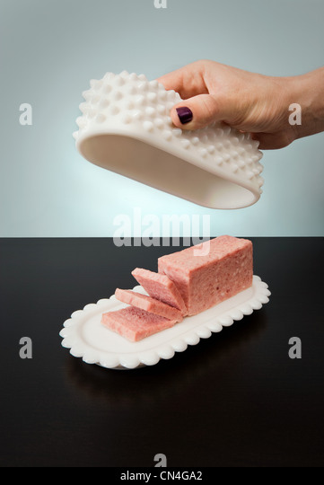 Spam in butter dish - Stock Image