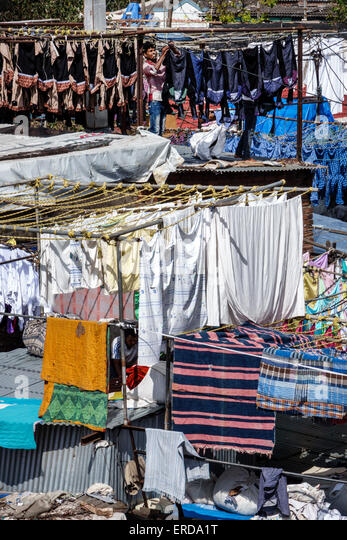 India Asian Mumbai Mahalaxmi Dhobi Ghat Dhobighat hanging laundry open air laundromat outdoor man working - Stock Image