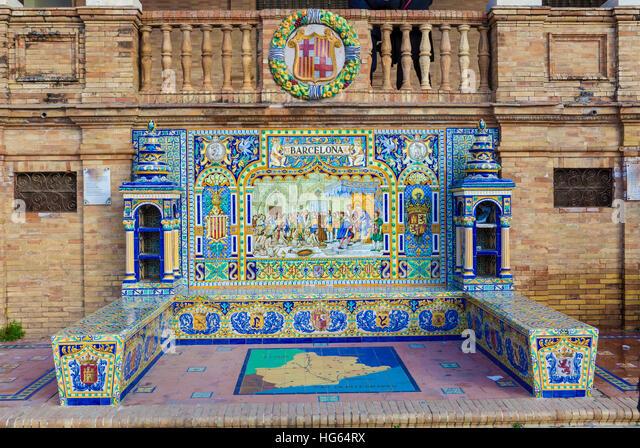 Glazed tiles bench of spanish province of Barcelona at Plaza de Espana, Seville, Spain - Stock Image