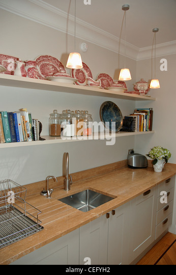 Shelves above kitchen sink stock photos shelves above for Traditional kitchen shelves