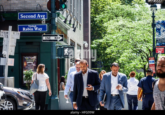 Manhattan New York City NYC NY Midtown Turtle Bay intersection Second Avenue Yitzhak Rabin Way Black businessman - Stock Image