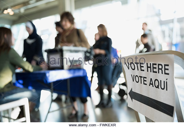 'Vote here' sign at polling place - Stock Image