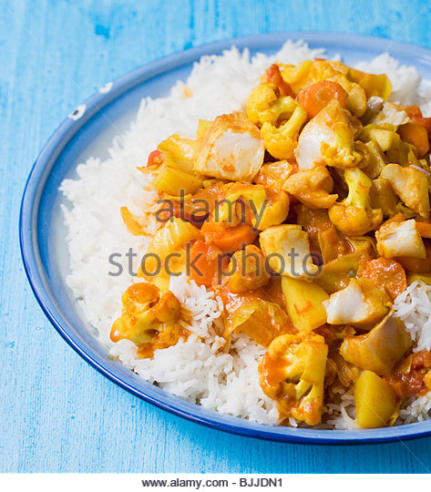 Fish and vegetable curry on rice - Stock-Bilder