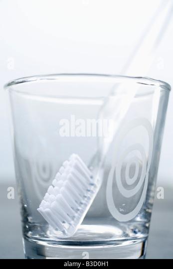 Tumbler, toothbrush, close up - Stock Image