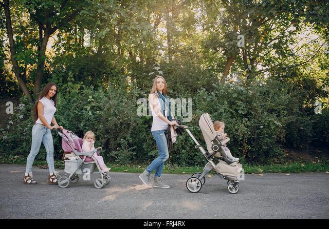 Family walk in the park - Stock-Bilder