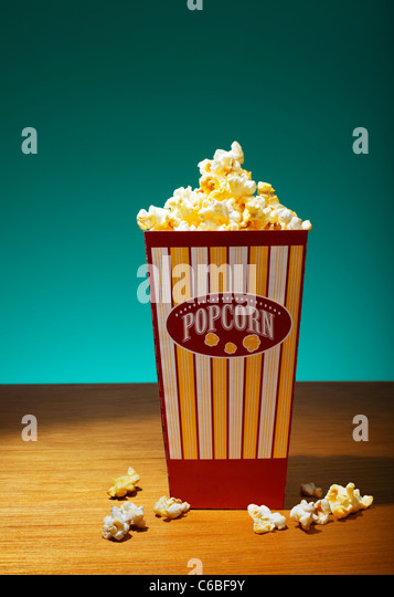 Popcorn in container on table - Stock Image