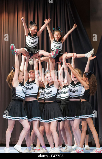 North West London junior cheer leading competition 2014 The Wolves team in acrobatic formation - Stock Image