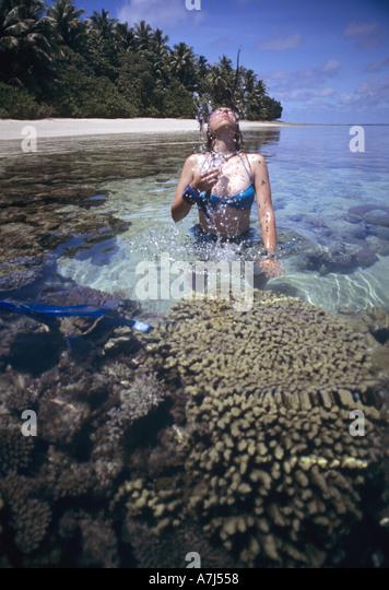 Bikini girl on reef - Stock Image