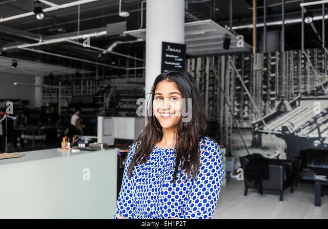 Portrait of happy female customer in factory - Stock Image