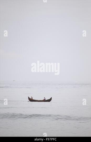 Friends Canoeing In Sea - Stock Image