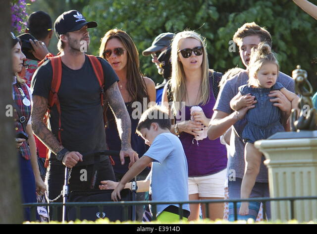 David and Victoria Beckham spend quality time with their kids at Disneyland. The famous family spent lots of time - Stock-Bilder