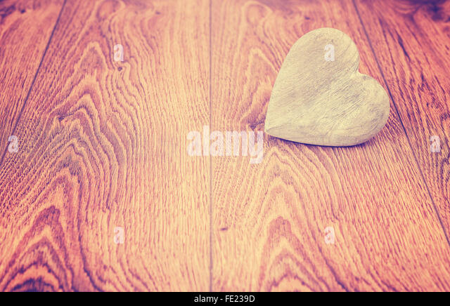Vintage stylized heart on wooden boards, space for text. - Stock Image