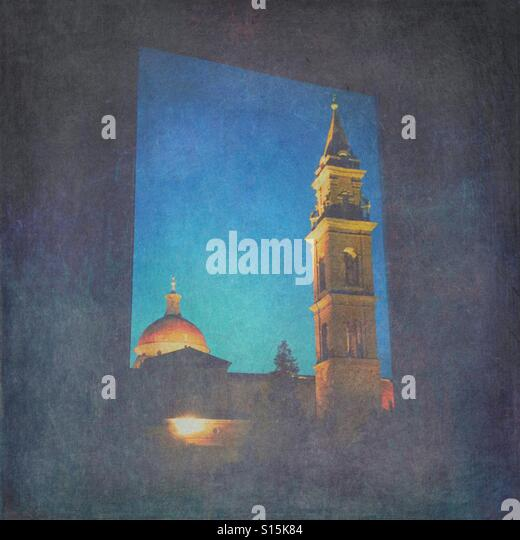 View of Basilica di Santo Spirito church early in the morning during blue hour, seen through window. Vintage paper - Stock Image