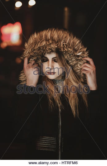 Young woman in furry winter coat - Stock Image