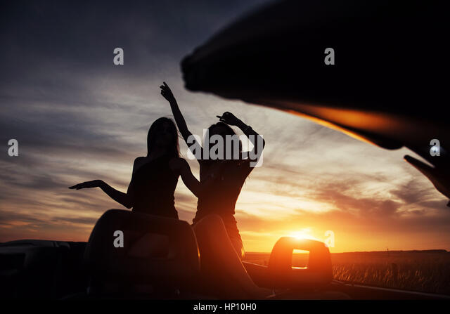 Young two women at a photo shoot. Girls gladly posing - Stock Image