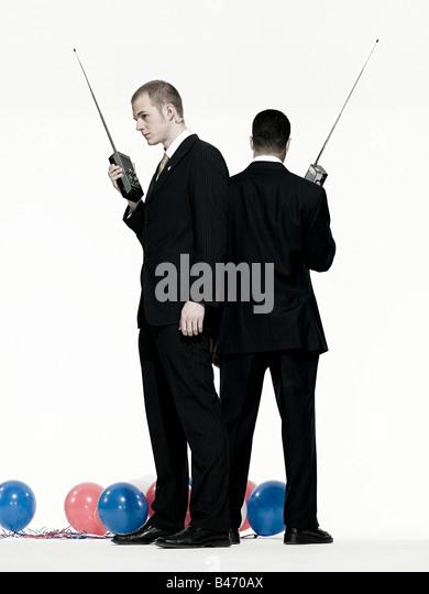 Men with walkie talkies - Stock Image
