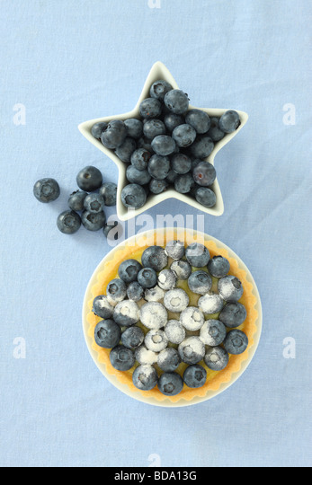Blueberry tart and fresh blueberries - Stock Image