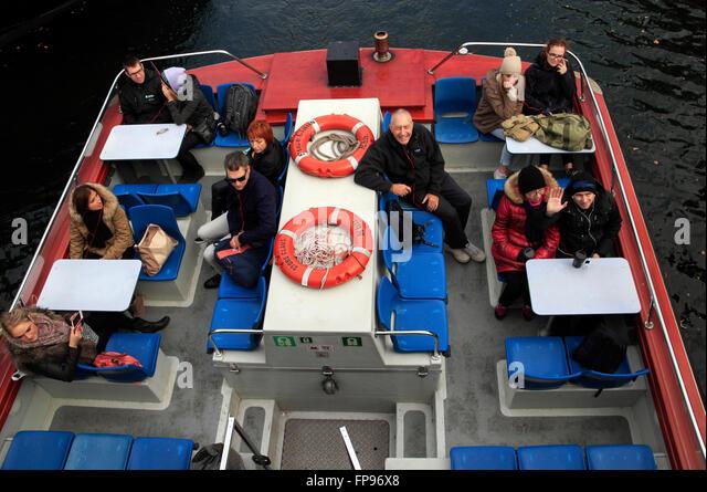 Passengers on a canal tour, Christianshavn, Copenhagen, Denmark - Stock Image