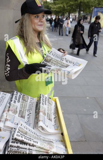 Manchester England UK Albert Square newspaper vendor Evening News - Stock Image