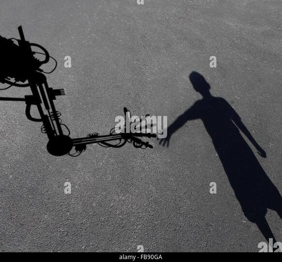 Technology helping children concept as a shadow of a child intreacting reaching out to an advanced computer aided - Stock Image