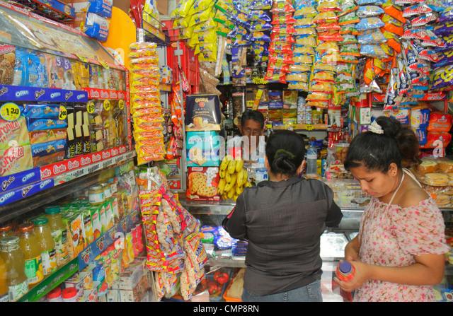 Lima Peru Barranco District Avenida Miguel Grau bodega convenience store market business shopping juice bottle snacks - Stock Image