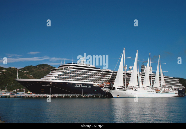 Cruise ships size contrast comparison large small tall sailing vessel Windstar side by side Holland America Zuiderdam - Stock Image
